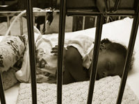 sick-baby-behind-bars